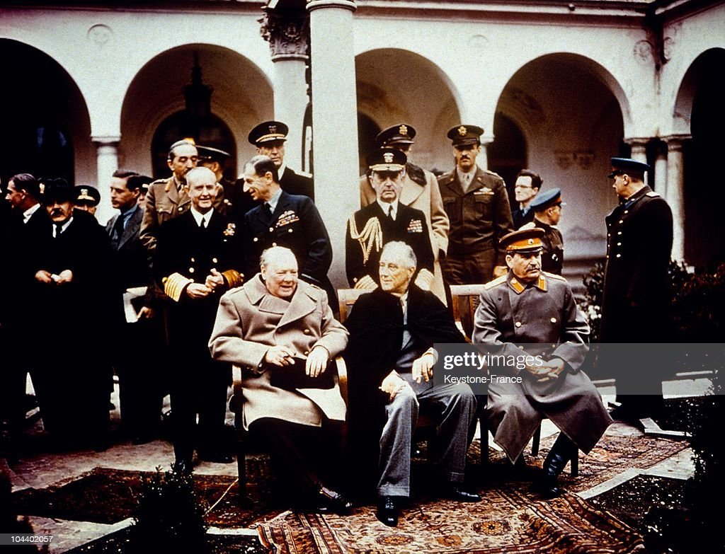 February 11, 1945. British Prime Minister Winston CHURCHILL, United States President Franklin Delano ROOSEVELT and Joseph STALIN pose together at the Livadia Palace in Yalta in the Crimea at the conclusion of the Yalta conference. Behind them are Admiral LEAHY and General MARSHALL.