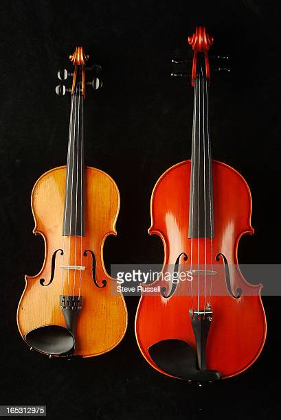 February 11 2009 A violin and a Viola note the similarities and the difference in size shape between the instruments Toronto Toronto Star/Steve...