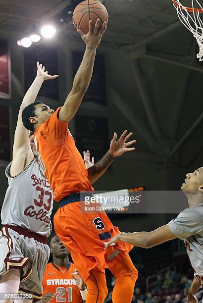 Syracuse University's Michael Gbinije goes in for a lay up past Boston College's Patrick Heckmann The Syracuse University Orange defeated the Boston...