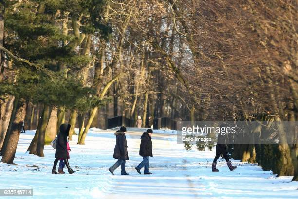 People walking in The Lazienki Park on February 11 2016 in Warsaw Poland Since the beginning of January 2017 Poland faced a differential weather...