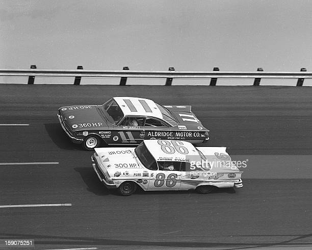 Ned Jarrett in a 1960 Ford races with Johnnie Dollar's 1958 Ford early in the second 100mile qualifier for the Daytona 500 NASCAR Cup race at Daytona...