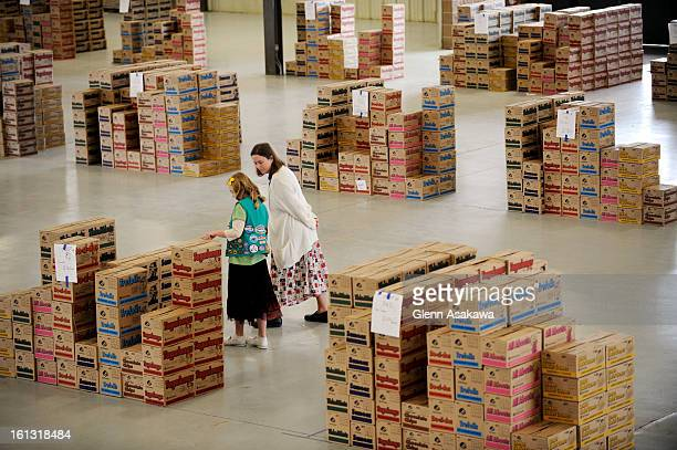 February 12 200812yearold Liza <cq> Hein <cq> and her mother Mary of Longmont look over boxes of Girl Scout cookies organized by troop and ready to...