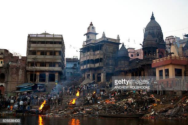"February 12, 2012 - The dead are burned on funeral pyres at Manikarnika Ghat, a cremation Ghat on the Ganges River at Varanasi. Known as the ""Gateway..."