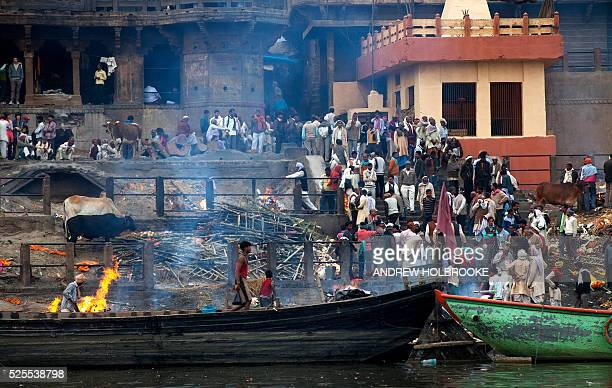February 12 2012 The dead are burned on funeral pyres at Manikarnika Ghat a cremation Ghat on the Ganges River at Varanasi Known as the Gateway to...