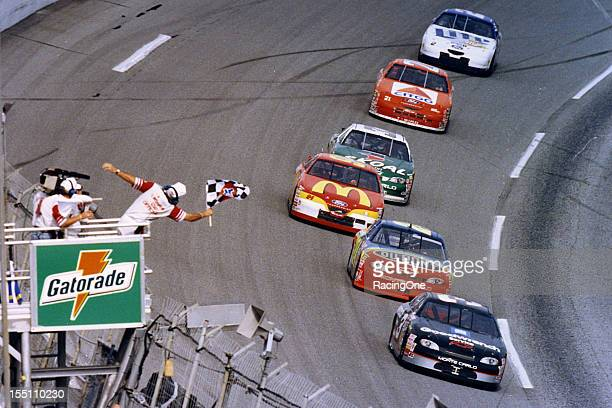 Dale Earnhardt takes the checkered flag to win the second Gatorade Twin 125 qualifying race for the Daytona 500 NASCAR Cup race at Daytona...