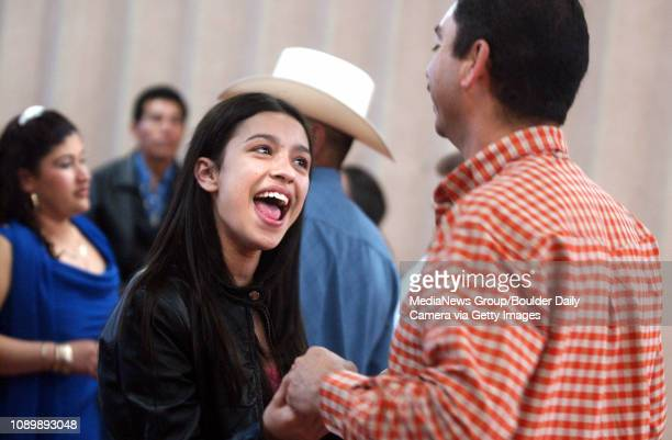 February 13 2005 / Boulder / Lilia Nunoz dances with her uncle Antonio Uribe during Lilia's quinceanera ceremony at the at the Holy Trinity Catholic...