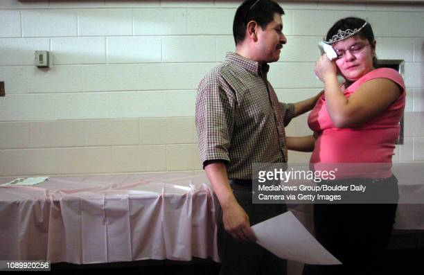 February 13 2005 / Boulder / Lorenzo Pacheco left consoles his daughter Erica Pacheco after her quinceanera ceremony where Lorenzo read a letter...