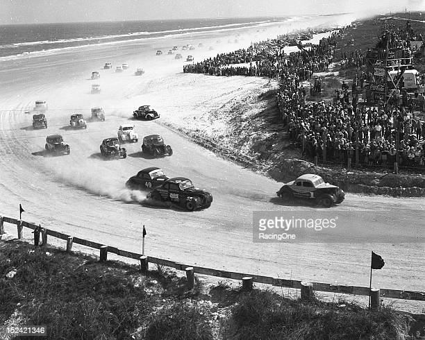 Russ Truelove Fred Thompson and Ralph Moody power through the North Turn of the Daytona BeachRoad Course during the NASCAR Modified race