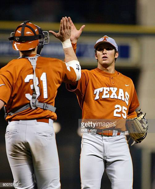 February 14 2004 Houston Texas Minute Maid ParkRice Owls vs Texas Longhorns Longhorn reliever Huston Street gets a high five from catcher Taylor...