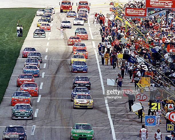 The field rolls along pit road at Daytona International Speedway in preparation for the start of the Daytona 500 NASCAR Cup race Bobby Labonte won...