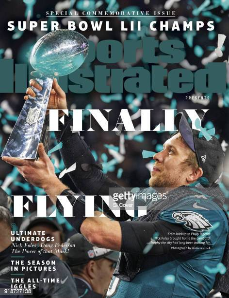 February 15 2018 Sports Illustrated Presents Cover Super Bowl LII Philadelphia Eagles QB Nick Foles victorious holding up Vince Lombardi trophy after...