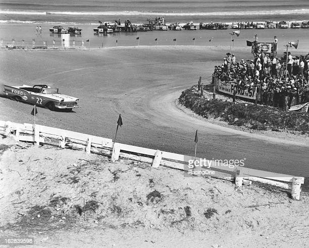 """Glen """"Fireball"""" Roberts broadslides his Ford through the north turn of the Daytona BeachRoad Course on his way to an eighth place finish in the..."""