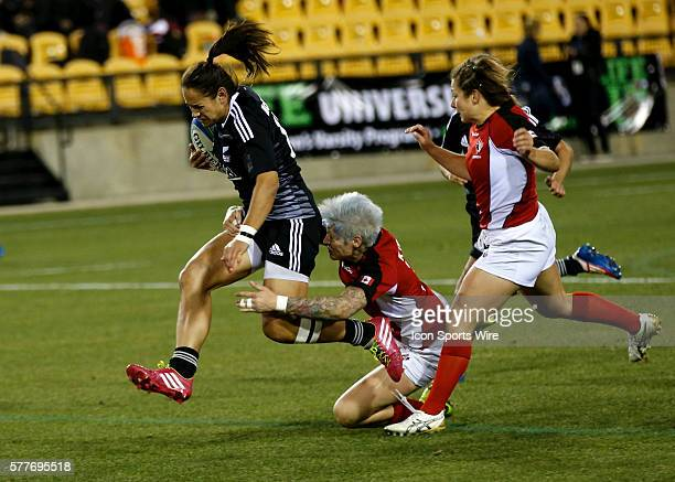 Kayla McAlister of New Zealand jumps over the tackle of Jennifer Kish of Canada during the final of the IRB Women's Sevens World Series at Kennesaw...