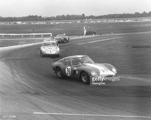 Roger Penske in a Ferrari 250 GTO leads the No 44 Porsche 356B Carrera of Mike Kurkjian during the Daytona Continental at Daytona International...