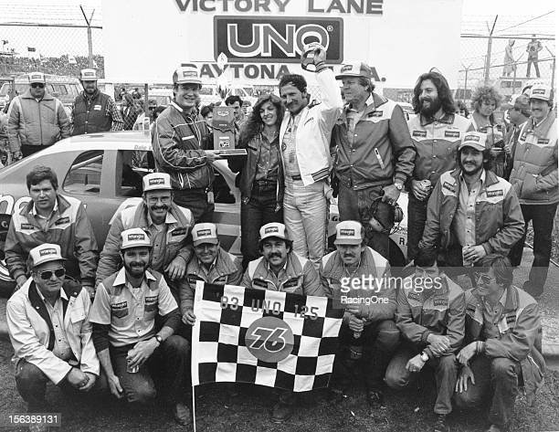 Dale Earnhardt is joined by his wife Teresa car owner Bud Moore and the rest of his crew in victory lane at Daytona International Speedway after...