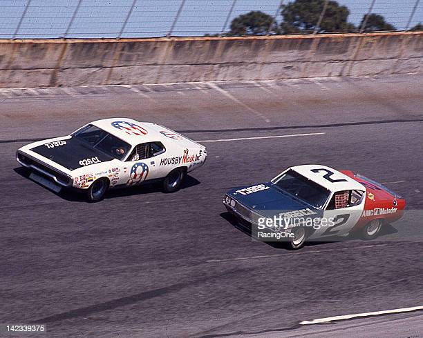 Action during the Daytona 500 NASCAR Cup race at Daytona International Speedway has Pete Hamilton in Jack Housby's Plymouth leading Dave Marcis in...