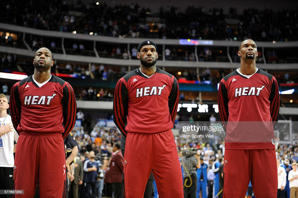 Miami Heat shooting guard Dwyane Wade #3, Miami Heat small forward LeBron James #6 and Miami Heat center Chris Bosh #1 observe the National Anthem before an NBA game between the Miami Heat and the Dallas Mavericks at the American Airlines Center in Dallas, TX Miami defeated Dallas 117-106