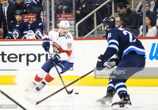 Florida Panthers forward Alexander Barkov moves in on Winnipeg Jets forward Blake Wheeler during the NHL game between the Winnipeg Jets and the...