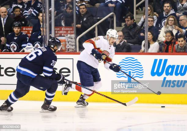 Florida Panthers forward Alexander Barkov skates away from Winnipeg Jets forward Blake Wheeler during the NHL game between the Winnipeg Jets and the...