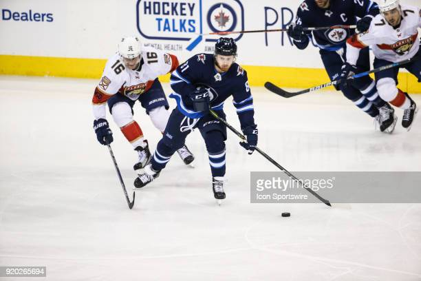 Winnipeg Jets forward Kyle Connor skates away from Florida Panthers forward Alexander Barkov during the NHL game between the Winnipeg Jets and the...