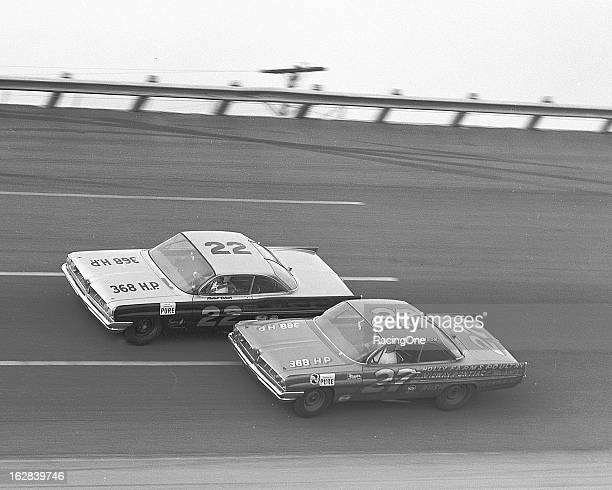 "Glen ""Fireball"" Roberts leads Junior Johnson during the special American Challenge Cup race for NASCAR Cup cars at Daytona International Speedway..."