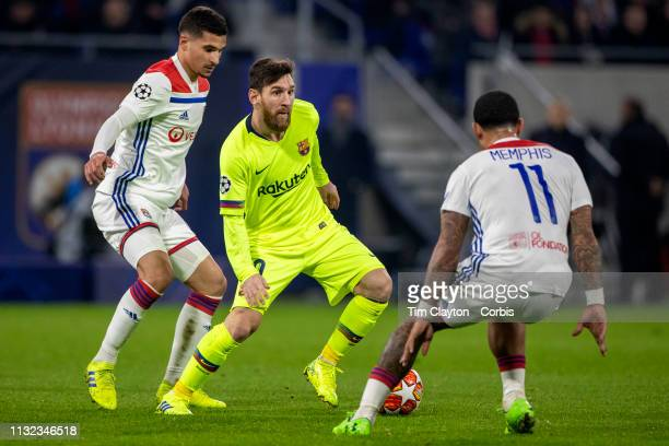 LYON FRANCE February 19 Lionel Messi of Barcelona defended by Houssem Aouar of Lyon and Memphis Depay of Lyon during the Lyon V Barcelona UEFA...