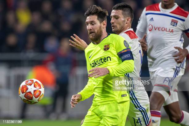 LYON FRANCE February 19 Lionel Messi of Barcelona defended by Leo Dubois of Lyon during the Lyon V Barcelona UEFA Champions League round sixteen 1st...