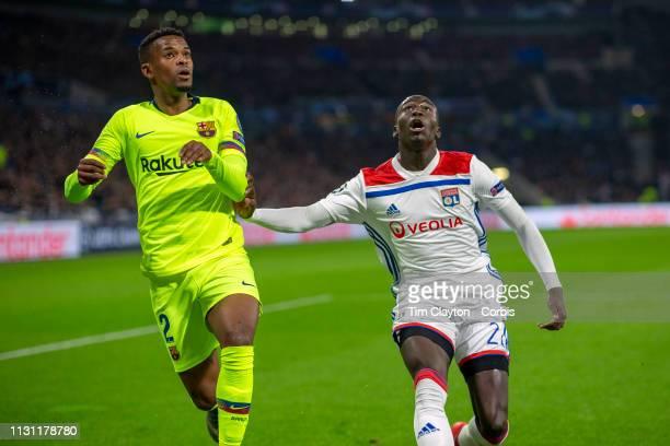 LYON FRANCE February 19 Nelson Semedo of Barcelona has his cross blacked by Ferland Mendy of Lyon during the Lyon V Barcelona UEFA Champions League...