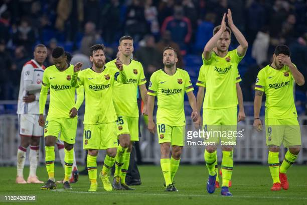 LYON FRANCE February 19 The Barcelona team salute their supporters at end of the game from left Nelson Semedo of Barcelona Lionel Messi of Barcelona...