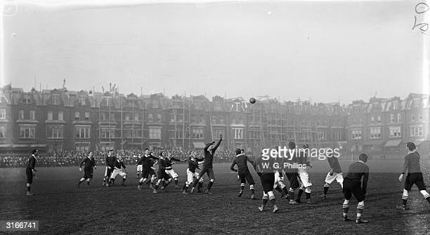 Action on the pitch during a British Army vs Royal Navy football match