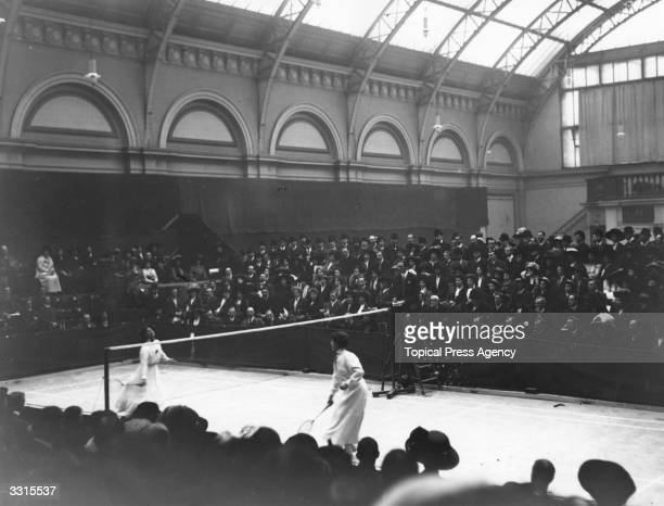 A ladies singles match in progress at the Badminton Championships at the Royal Horticultural Hall