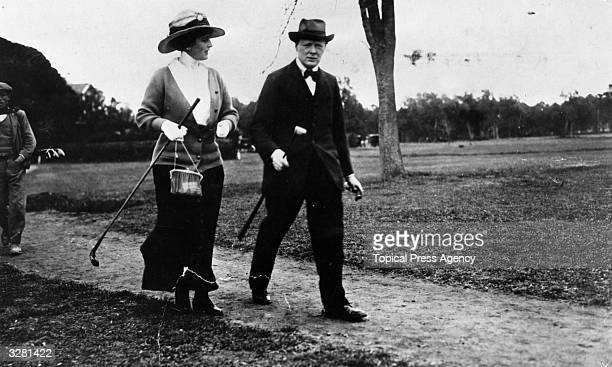 British statesman and prime minister Winston Churchill with Miss Elliot at the golf links at Cannes