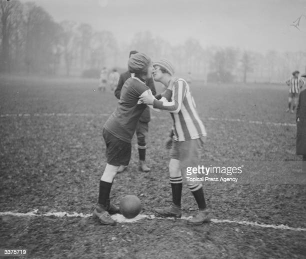 Two members of the Lyons girls' football teams kissing each other during a match