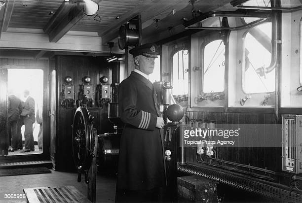 Captain F B Howarth mans the bridge of the newlyacquired White Star liner Homeric formerly the Norddeutscher Lloyd vessel Columbus