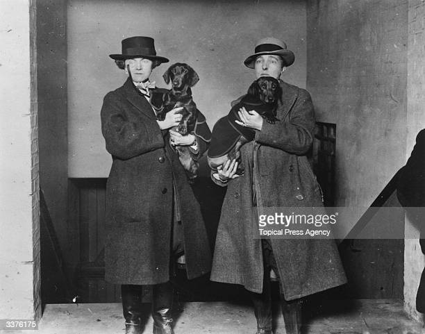 Author Radclyffe Hall, right, and Lady Una Trowbridge with their daschunds at Crufts dog show.