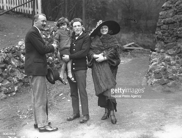 British boxer Ted 'Kid' Lewis with his wife and son and Captain Goolden at Richmond.