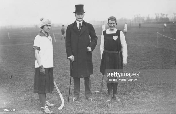 The French ambassador with Miss KC Lidderdale and Mlle G Seroux captains of the France versus England ladies hockey match