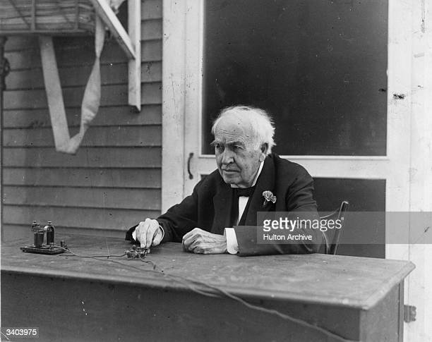 Inventor Thomas Alva Edison operating a telegraph key on his 81st birthday The key he is pressing is actually inaugurating a modern Elison lighting...