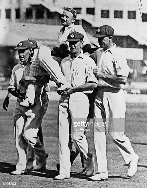 Don Bradman is chaired by team mates after his amazing innings of 432 not out when playing for New South Wales against Queensland Sir Donald Bradman...