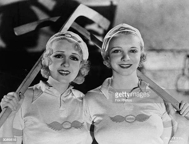 Actresses Anita Page and Virginia Bruce model the sportswear designed to celebrate the Los Angeles Olympic Games The hats and sweatshirts are...