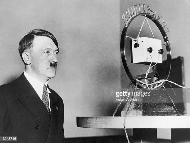 Nazi leader Adolf Hitler makes his first radio broadcast as German Chancellor in front of a radio microphone