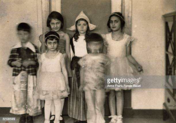 EXCLUSIVE A fulllength portrait of Anne Frank her sister Margot Frank and four friends wearing costumes at Margot's birthday party Amsterdam the...