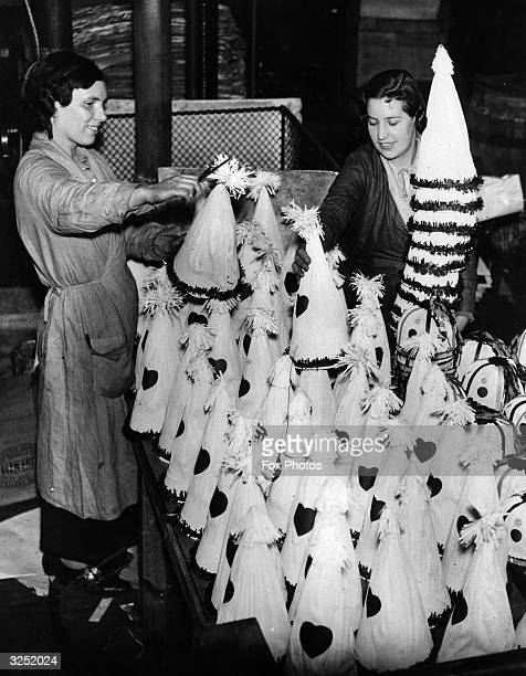 Preparing carnival hats for the King's Jubilee at a Walthamstow factory