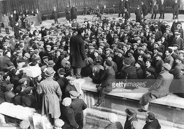 London dock workers gathered outside Victoria Docks for a meeting concerning their strike