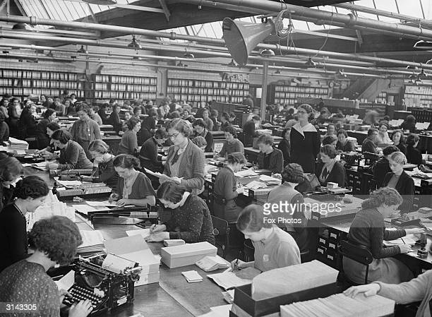 Office workers at Vernon's football pools in Liverpool.