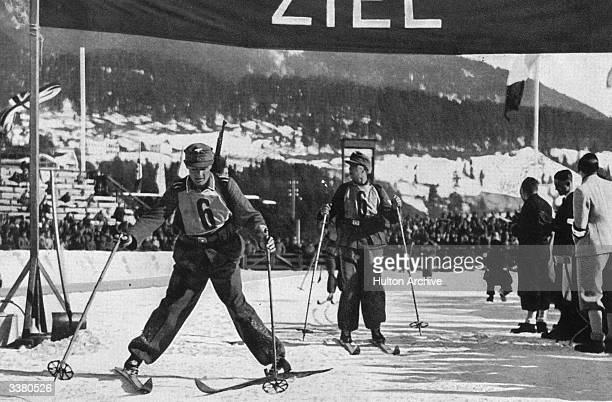 The German biathlon team at the finishing post at the Winter Olympic Games at GarmischPartenkirchen