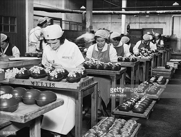 Workers at the Meltis chocolate factory in Bedford making Easter eggs with special designs celebrating the coronation of George VI