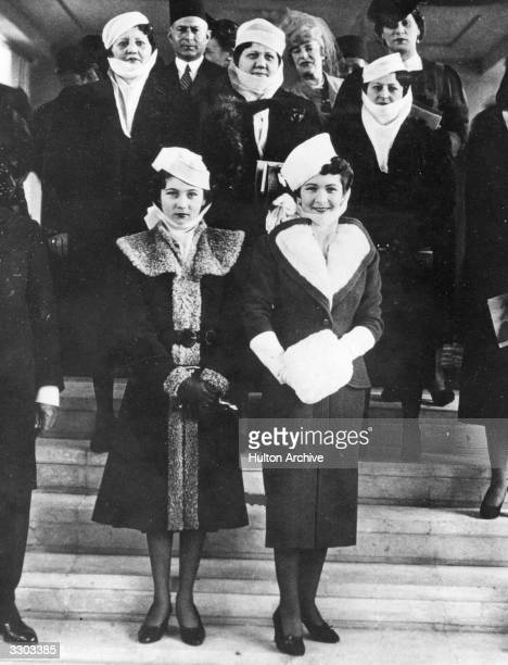 Farida Queen of Egypt the first wife of King Farouk I of Egypt at the opening of the French sculpture exhibition in Cairo She is with Princess Fawzia