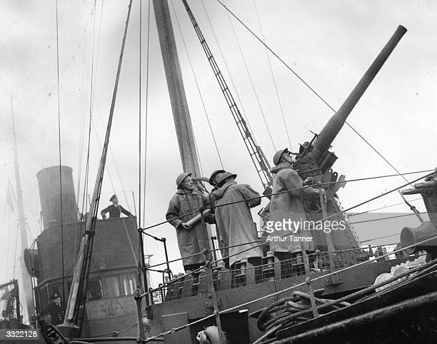 Fishermen man an antiaircraft gun during training at an East Coast port for service in Minesweepers Original Publication Picture Post 230 A Day On A...