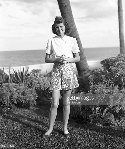 Full-length portrait of Eunice Kennedy , later Mrs. Sargent Shriver, on the beach at Palm Beach, Florida.